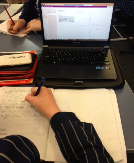 A student reviewing the MS OneNote content recorded moments earlier by Mr Hilliam, and then practicing in his exercise book.