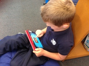 A student using an iPad in class