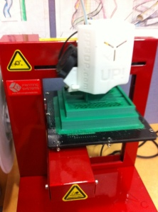 The 3D printer creating the Minecraft setting created by a student